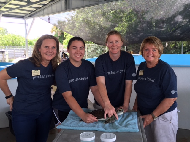 Brevard Zoo's eLearning team wearing their Academy shirts
