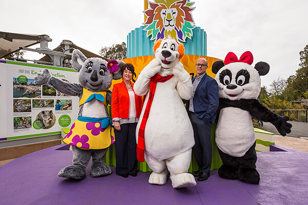 Roar book authors Sandy Asch and Tim Mulligan pose with San Diego Zoo costiume characters at the Zoo's Centennial Plaza.